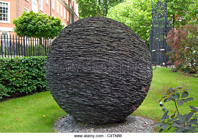 Globe sculpture in grey slate by Joe Smith