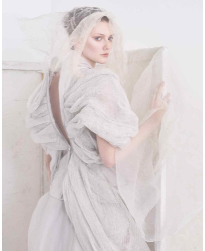 Credits: FT How To Spend It. Photography: Damian Foxe. Description: Rick Owens linen/cotton top, £1,535, and silk skirt, £1,856. Veil, stylist's own
