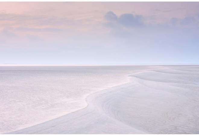 Landscape Photographer of the Year, overall winner: Benjamin Graham. A sunset colours the sea and land as the tide meets West Wittering Beach