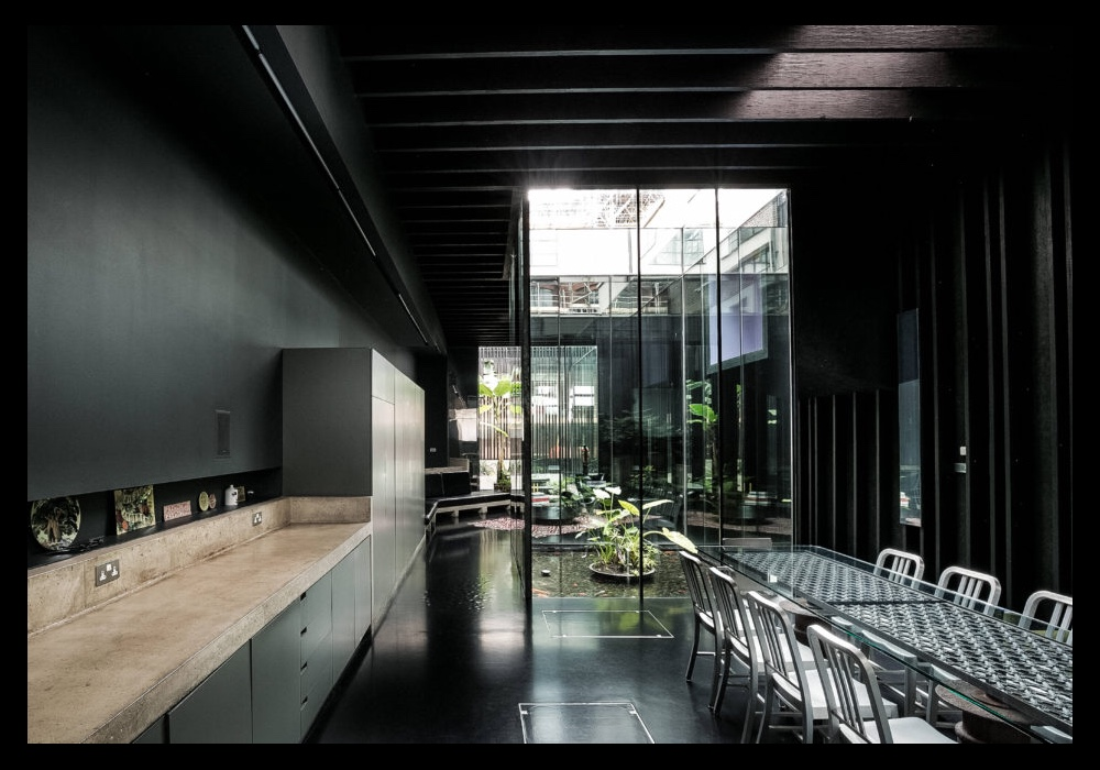 David Adjaye's Lost House: View from the kitchen to the central light well water garden