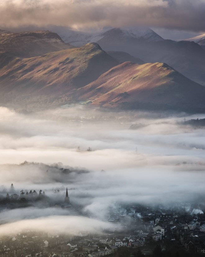 Commended: Stephen Fairbrother. A blanket of mist shrouds the town of Keswick, as viewed from Latrigg Fell in the Lake District