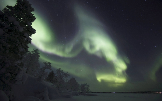 Lapland is illuminated by the aurora borealis over Inari, Finland Lehtikuva/Irene Stachon/Reuters The Times, Wednesday 27 December 2017