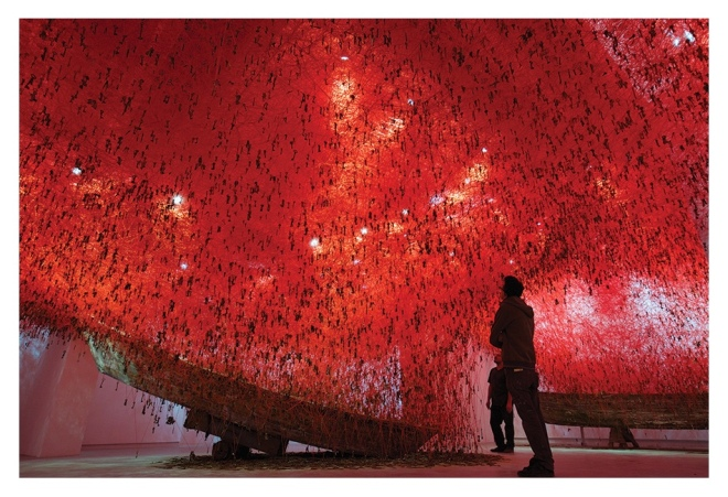 Chiharu Shiota: The Key in the Hand, 2015, old keys, old wooden boat, red yarn, dimensions variable. Japan Pavillion 56th Venice Biennale, Italy. Photo by Sunhi Mang. Courtesy of the Artist.