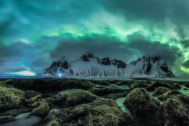 The lights loom over the mountains in Stokknes on the southern coast of Iceland JINGYI ZHANG/ROYAL OBSERVATORY INSIGHT INVESTMENT ASTRONOMY PHOTOGRAPHER OF THE YEAR