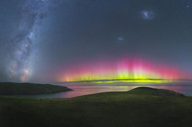 The flared up southern lights reflect bright colours on the water at Southern Bays near Christchurch, New Zealand PAUL WILSON/ROYAL OBSERVATORY INSIGHT INVESTMENT ASTRONOMY PHOTOGRAPHER OF THE YEAR